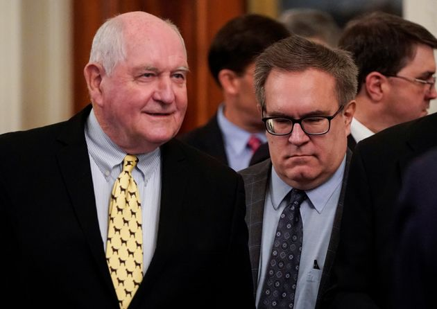 Secretary of Agriculture Sonny Perdue stands beside Environmental Protection Agency Administrator Andrew