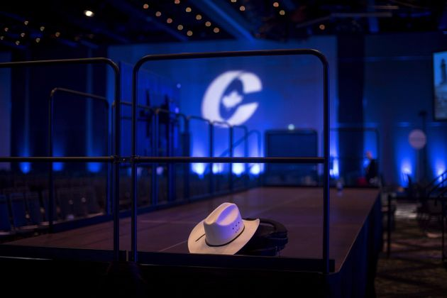 A cowboy hat is left inside an empty ballroom at the Conservative national convention in Halifax on Aug....