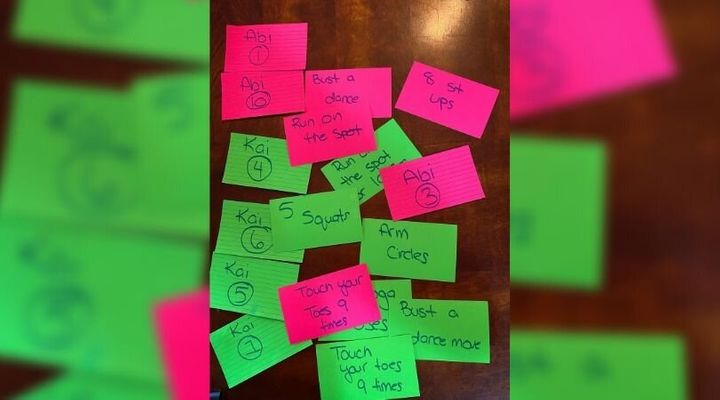 Parent Kathryn Connors wrote out cue cards to get her kids to exercise.