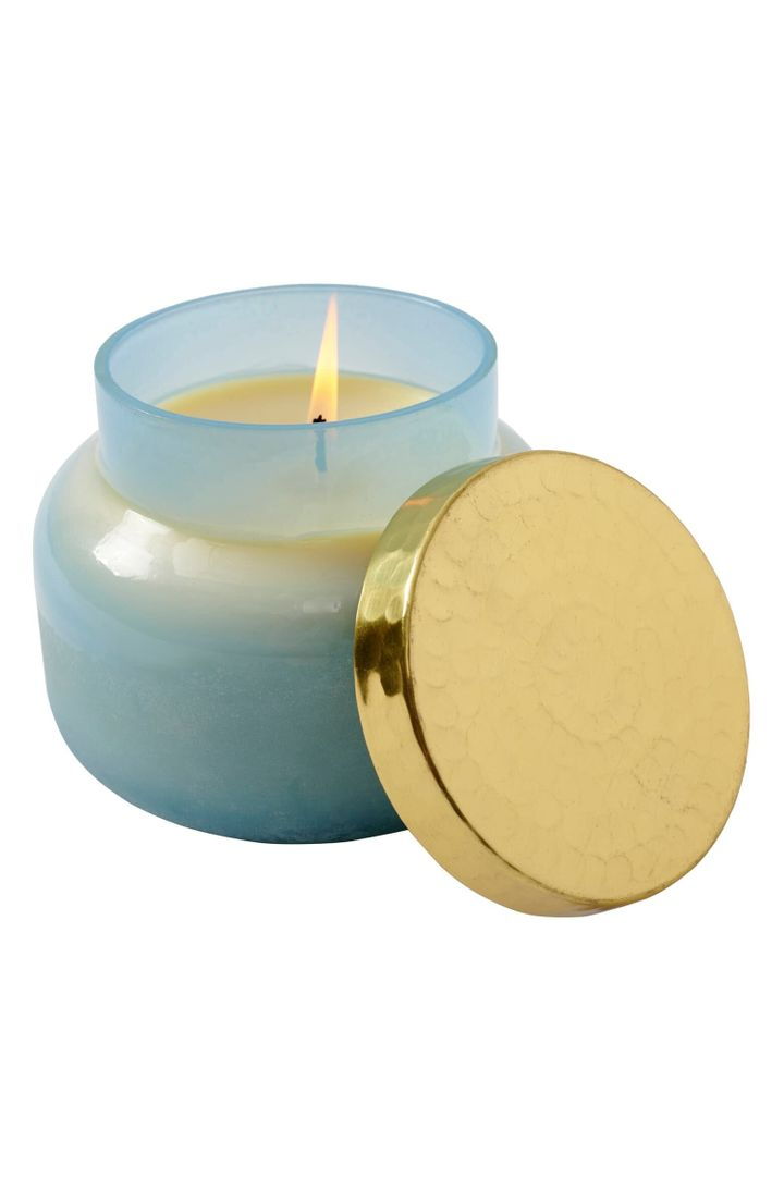 A hand-poured candle presented in a beautiful lidded vessel fills your home with an enticing scent.