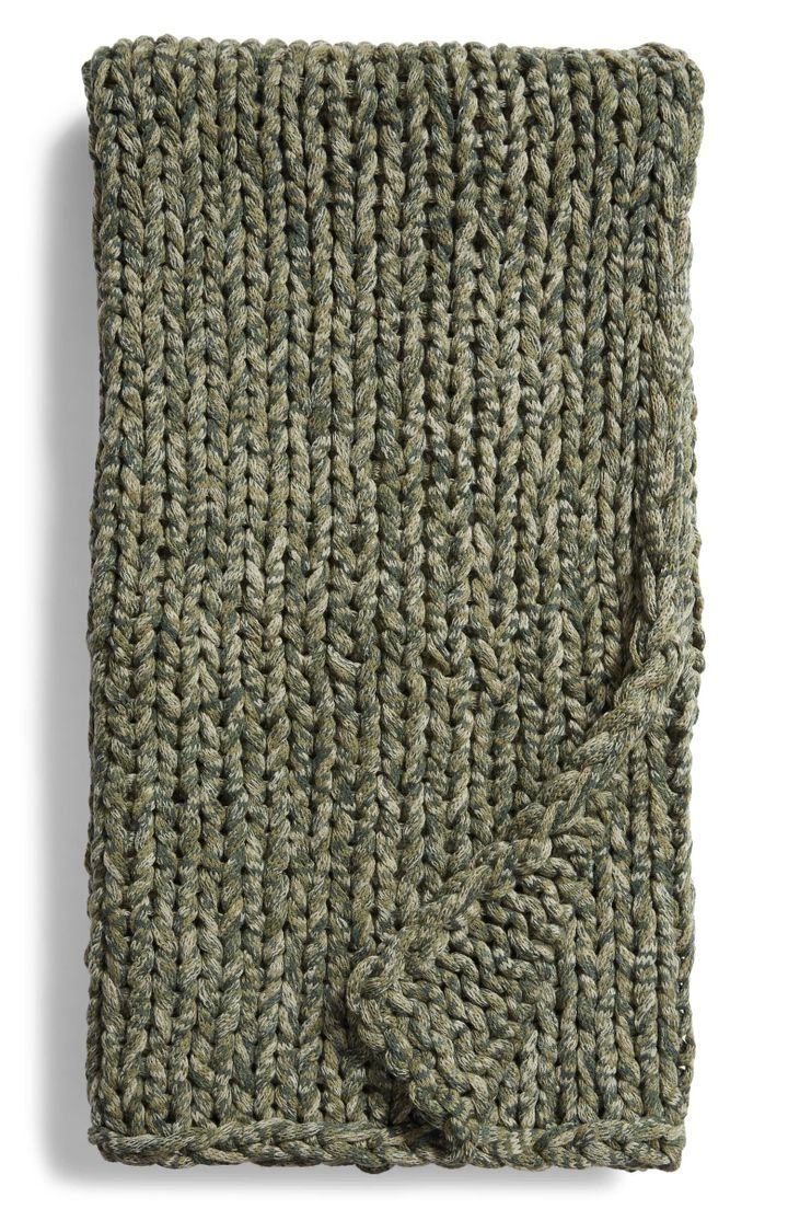 Space-dyed yarns give this soft and cozy knit throw blanket a gorgeous depth.