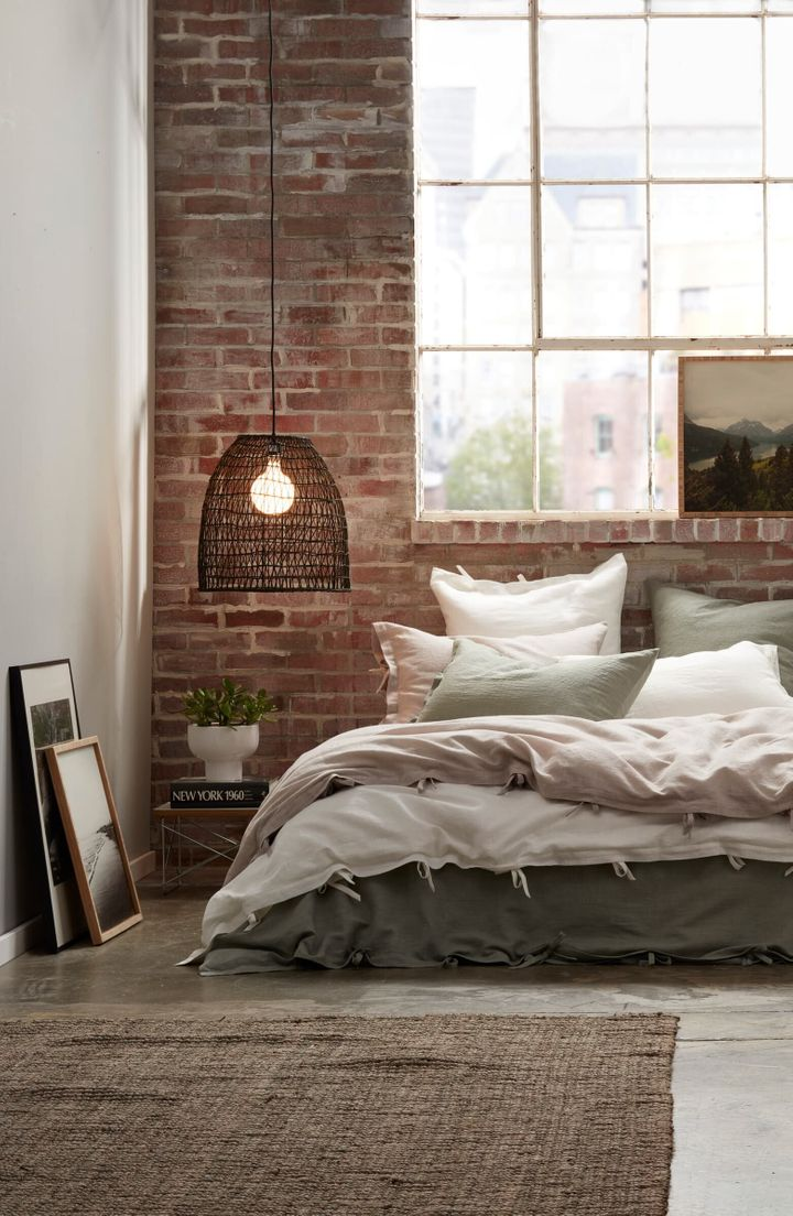 This cotton-and-linen duvet cover with its natural texture and casual ties perfects an artfully disheveled bed.