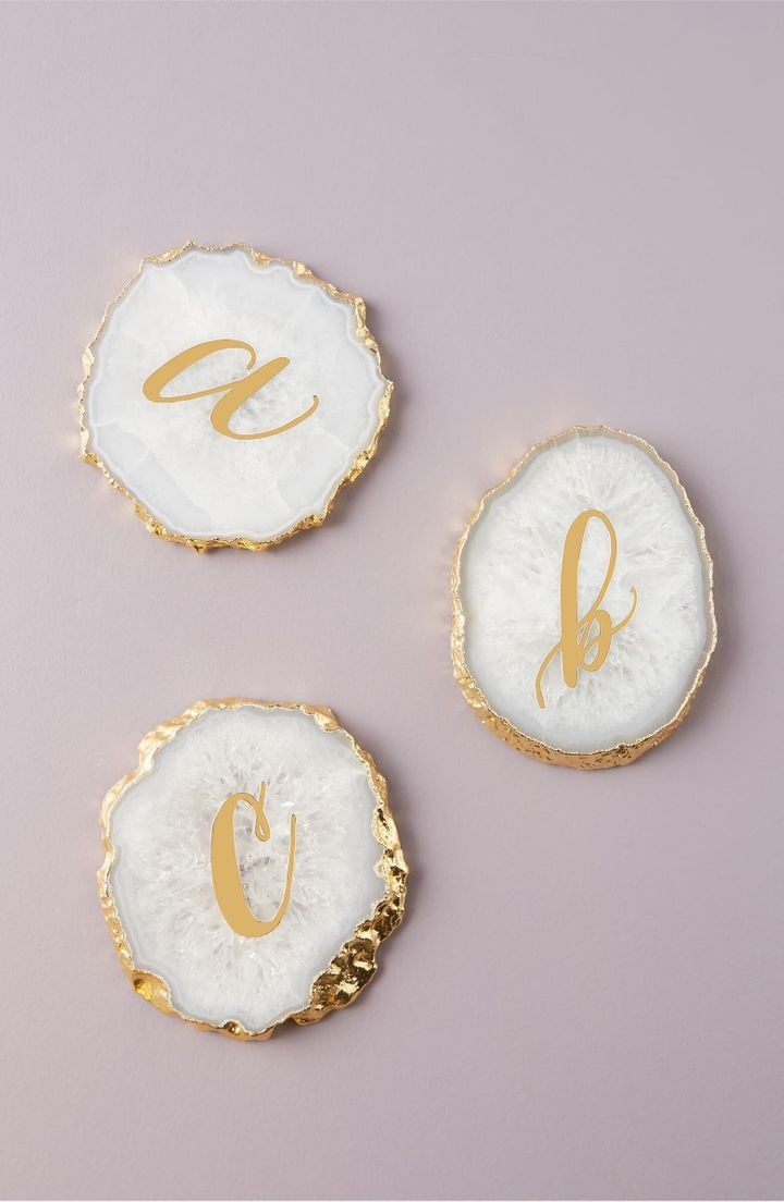 A shining monogram adds personalized polish to a coaster handcrafted in lustrous sliced agate.