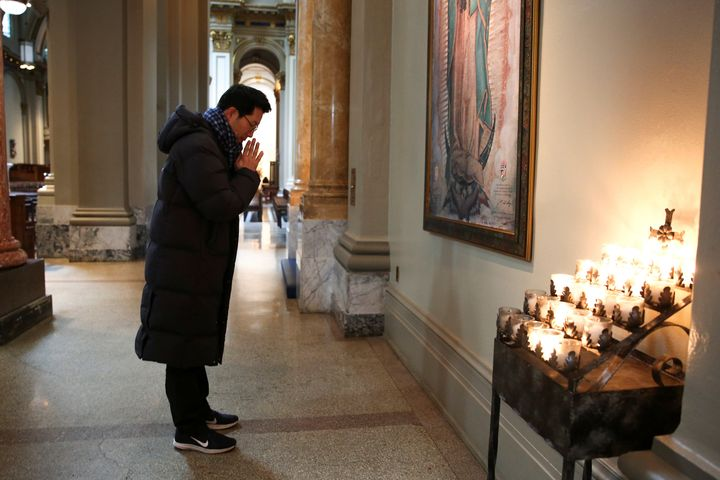 Jun Lee, a Catholic from South Korea, prays during a visit to St. James Cathedral in Seattle, which is open only for prayer a