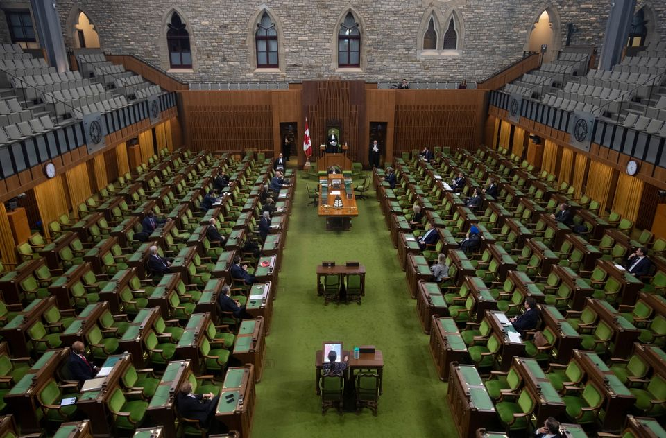 Members of the House of Commons attend an emergency sitting on March 24, 2020 in