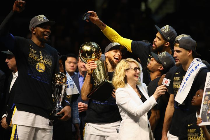 NBA analyst Doris Burke pictured alongside the Golden State Warriors after the team defeated the Cleveland Cavaliers in