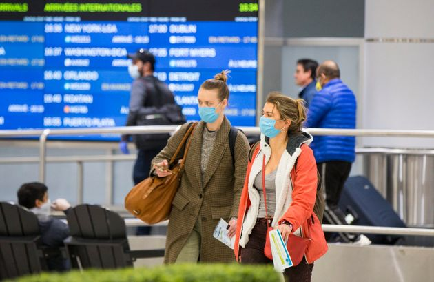Passengers arrive at Toronto Pearson International Airport on March 16,