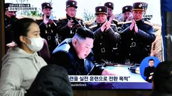 North Korea fires missiles into sea, criticised by
