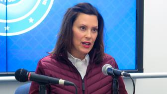 Michigan Gov. Gretchen Whitmer announces the state's first two cases of coronavirus, Tuesday, March 10, 2020, at the Michigan State Police headquarters in Windsor Township, Mich. She declared a state of emergency and urged residents to help slow the spread. Two people in the Detroit area have tested positive for the coronavirus infection, Michigan officials announced. A woman in Oakland County had traveled outside the country, while a man from Wayne County had traveled within the U.S., said Dr. Joneigh Khaldun, Michigan's medical executive. (AP Photo/David Eggert)