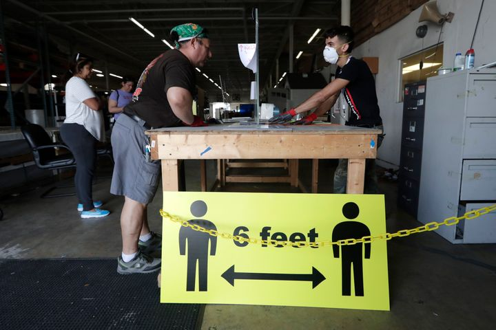 A sign advises social distancing of 6 feet to protect against the coronavirus in Hialeah, Florida.