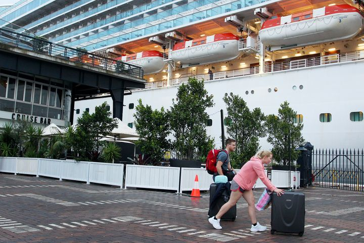 Passengers disembark from the Ruby Princess at Overseas Passenger Terminal on February 08, 2020 in Sydney, Australia.