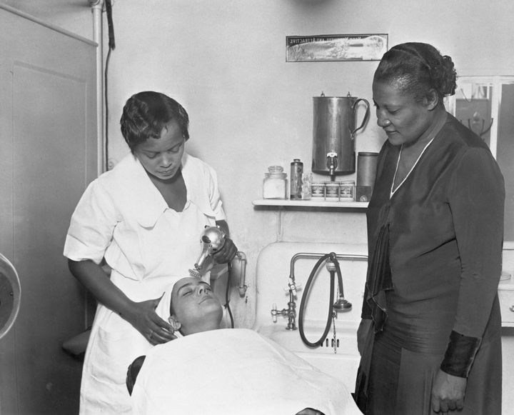 Harlem, New York: A'Lelia Walker is shown supervising a facial in one of Madam C.J. Walker's many beauty parlors.