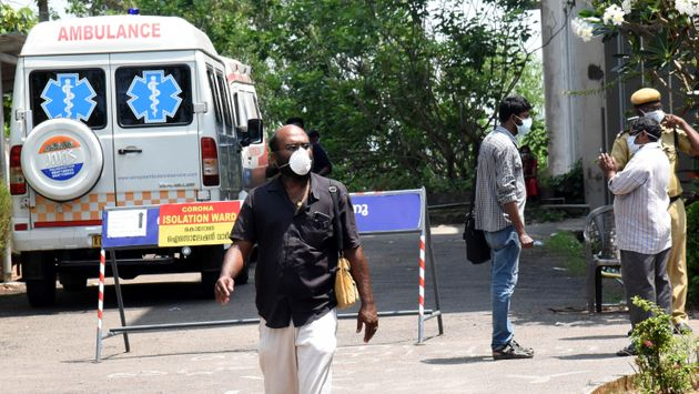 People seen wearing masks outside the special isolation ward set up to provide treatment to novel coronavirus...