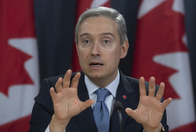 Foreign Affairs Minister Francois-Philippe Champagne responds to a question during a news conference...