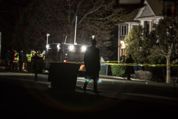 Authorities and first responders gather in front of a residence in Monsey, N.Y., following a stabbing late Saturday dur