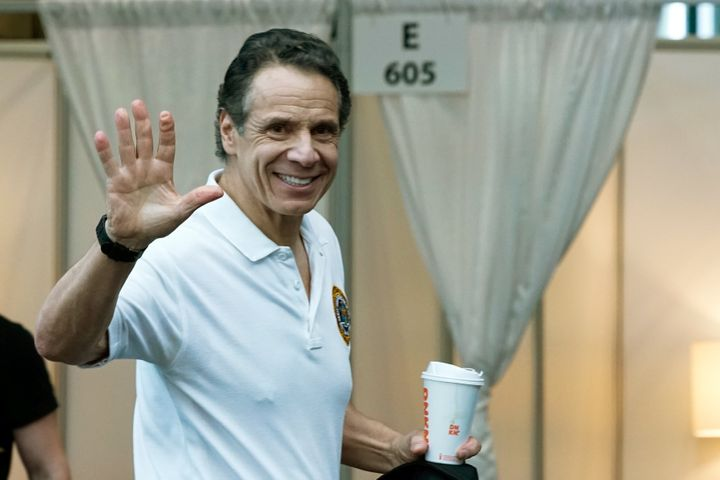New York Gov. Andrew Cuomo (D) waves on Friday after he gave what has become daily briefings on the state's battle against th