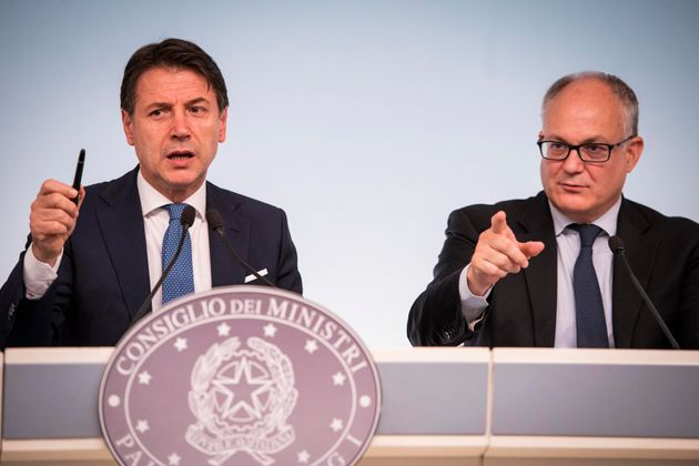 Italian Prime Minister Giuseppe Conte and Italian minister for Economy Roberto Gualtieri hold a press...
