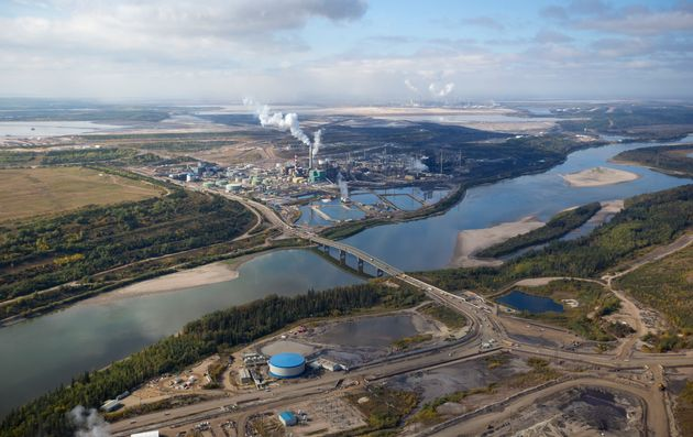 In this undated stock photo, an aerial view of a large oil refinery is seen along the Athabasca River...