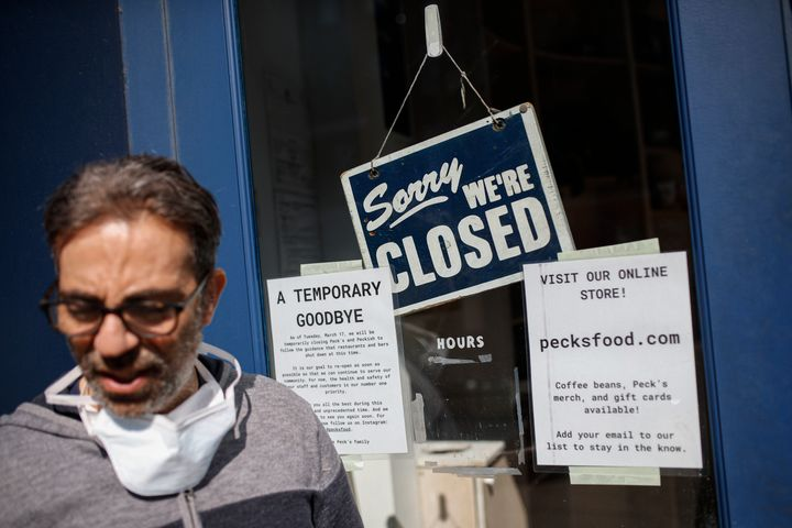 Peck's Food owner Theodore Peck stands outside his closed business on March 18, 2020, in Brooklyn's Clinton Hill neighborhood