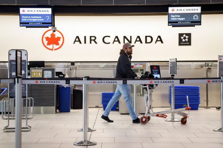 An Air Canada check-in desk at the airport in Calgary, Alta., Wed. March 25, 2020, amid a worldwide COVID-19 flu pandemic.