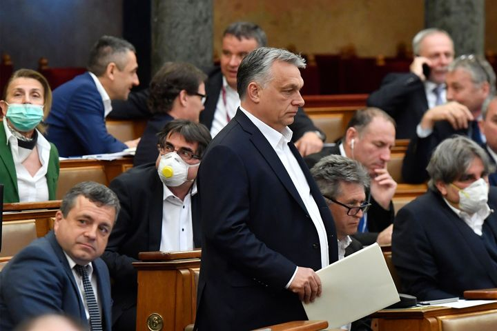 Hungarian Prime Minister Viktor Orban (standing) at the session of the Hungarian Parliament in Budapest on Monday where his g
