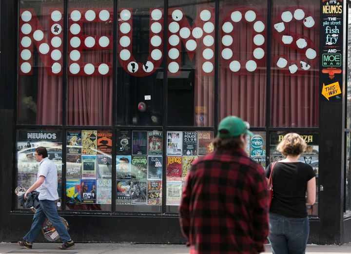 "Pedestrians walk past Neumos music club in Seattle on April 10, 2014. ""Taking a loan right now is ludicrous until"