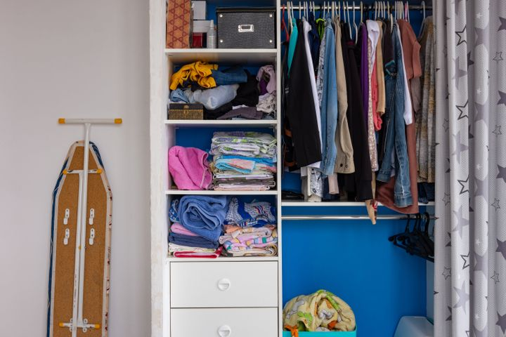 To start cleaning you closet, begin by sorting clothes into three piles: donate, repair and keep.