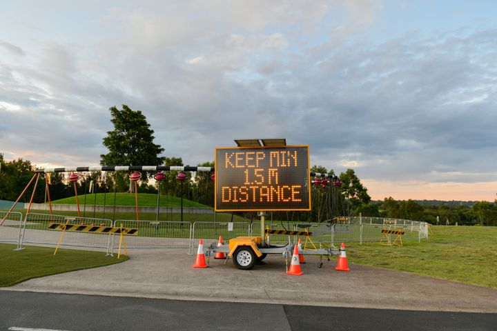 An information signboard 'Keep min 15m distance' is seen at outdoor playground at Sydney Olympic Park area on March 30, 2020 in Sydney, Australia. (Photo by Izhar Khan/NurPhoto via Getty Images)