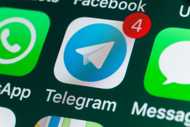 London, UK - July 30, 2018: The buttons of Telegram, WhatsApp, Facebook, Messages and other apps on the...