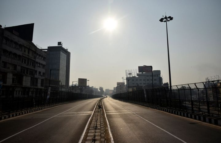 A view of deserted road in Guwahati city during Assam Bandh called by All Assam Students' Union (AASU) and Northeast Students organisation (NESO) against the Citizenship (Amendment) Bill, 2016.