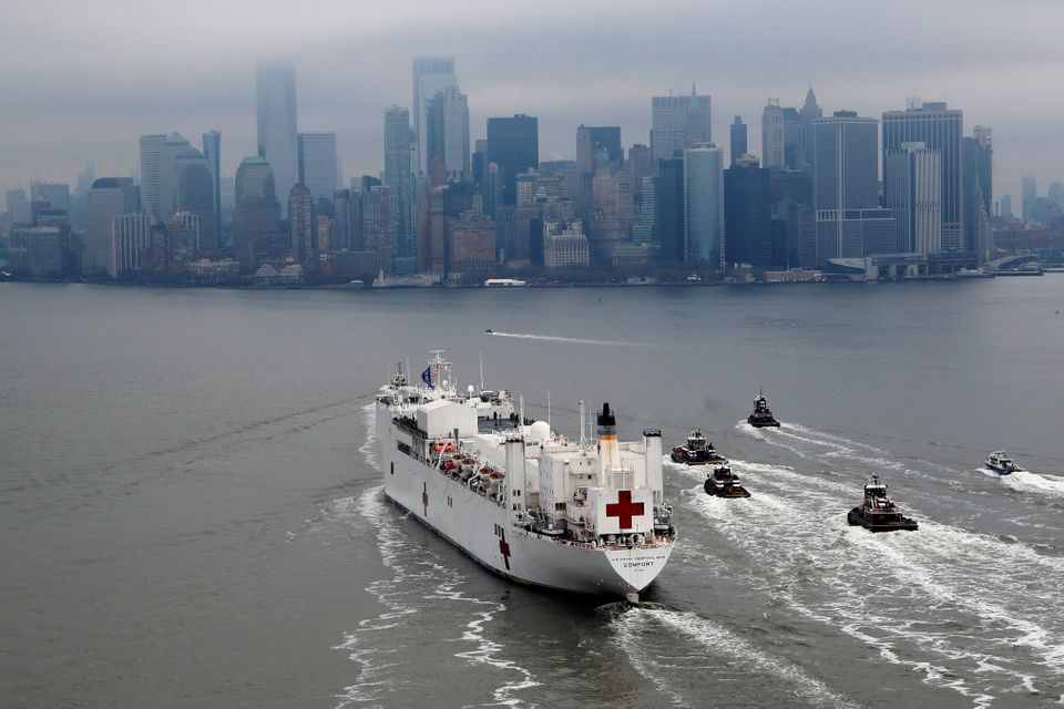 The USNS Comfort passes Manhattan as it enters New York