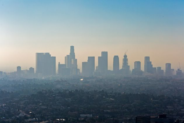 Downtown Los Angeles with a layer of smog. Levels of pollution in the city have dropped, but experts...