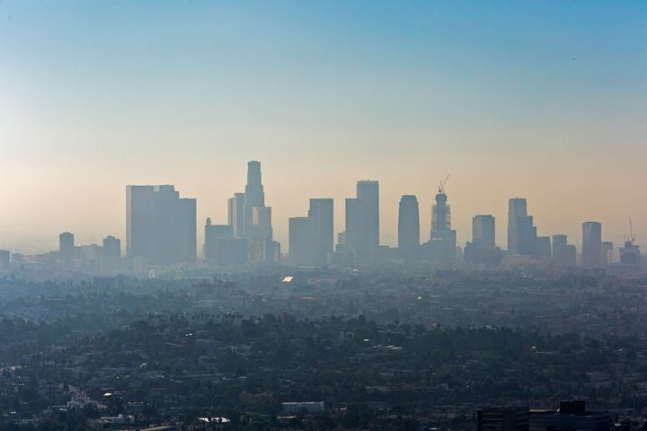 Downtown Los Angeles with a layer of smog. Levels of pollution in the city have dropped, but experts say it's only temporary.