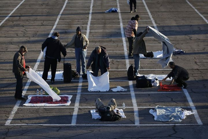 Homeless people in Las Vegas have been directed to sleep in rectangles painted on the pavement in a makeshift parking lot cam