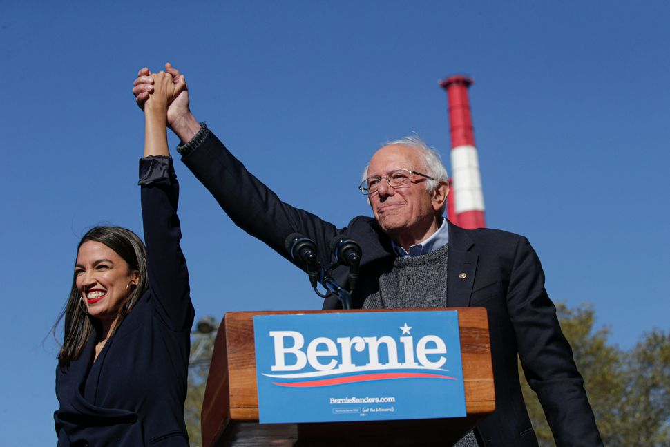 Rep. Alexandria Ocasio-Cortez (D-N.Y.), left, endorsed Sanders at a rally in Queens on Oct. 19. Her support sparked a comebac