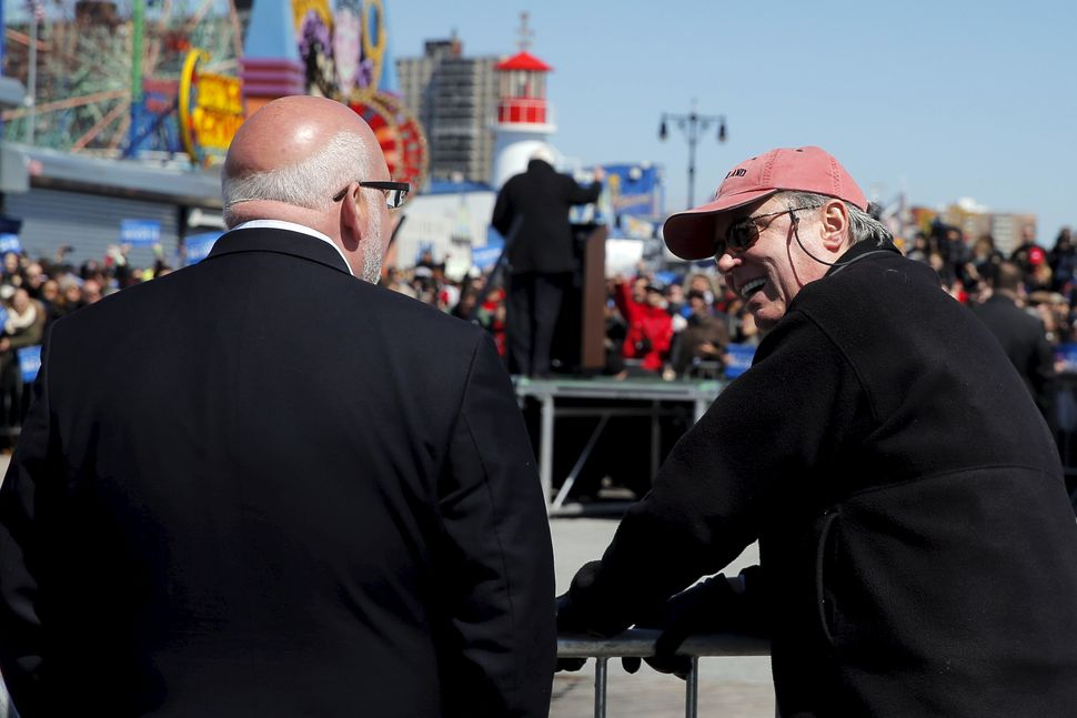 Jeff Weaver, left, speaks with strategist Tad Devine at a Sanders campaign rally in April 2016. For Sanders' second run, Weav