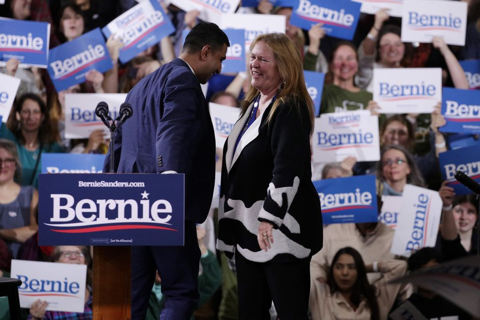 Sanders campaign manager Faiz Shakir greets Jane Sanders at a March 3 rally. Shakir's critics believe his decision to regular