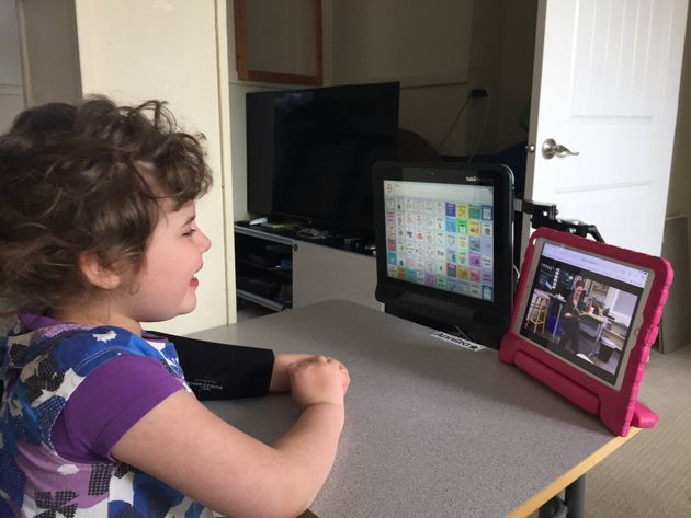Duane Froese's daughter participates in a session with her educational