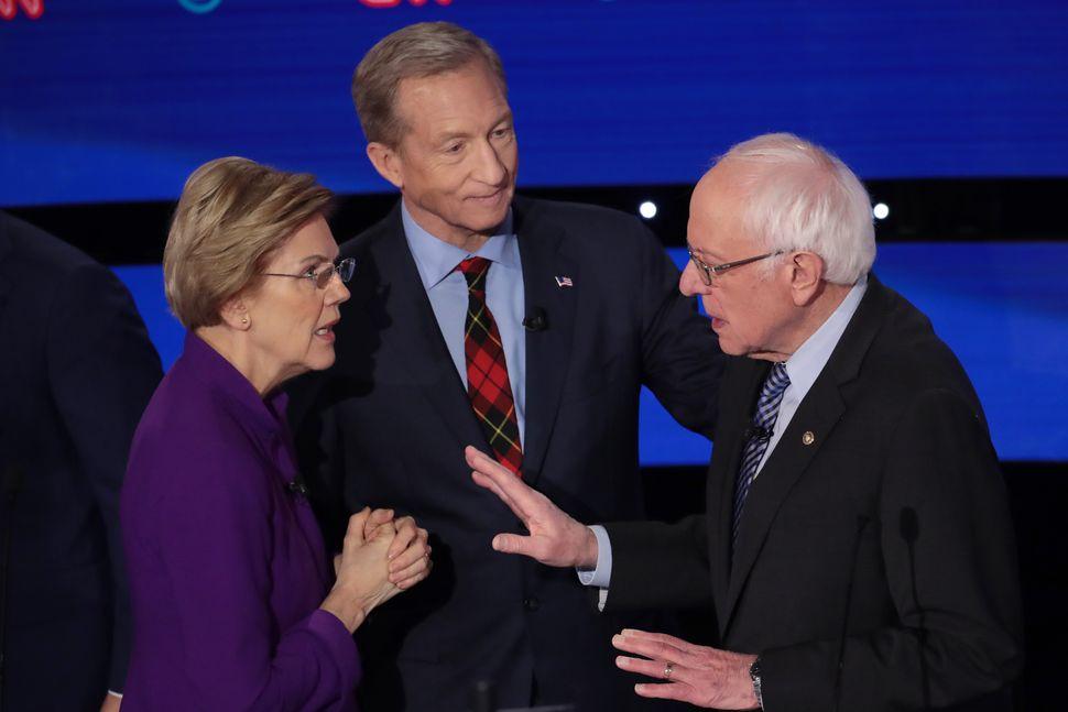 Sen. Elizabeth Warren (D-Mass.), left, and Sanders, right, have a tense conversation after the Jan. 14 debate as Tom Steyer l