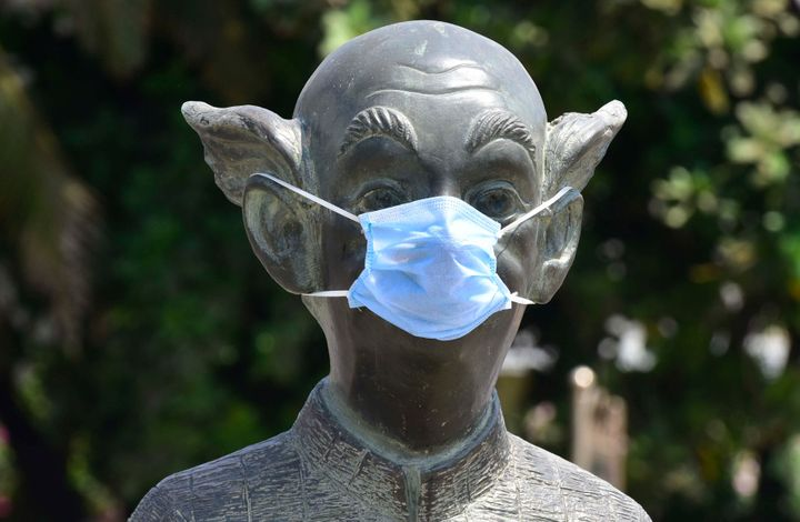 """Protective mask put up on """"Common Man"""" statue, following COVID 19 pandemic Worli Seaface, on March 30, 2020 in Mumbai."""