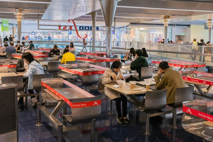 Customers sit in a canteen with taped off seatings to make sure people adhere to social distancing during a coronavirus (COVID-19) on March 29, 2020 in Hong Kong, China.