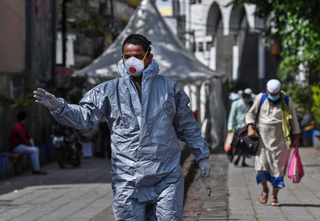 A government official in protective gear in New Delhi's Nizamuddin West on March 31, 2020 in New...