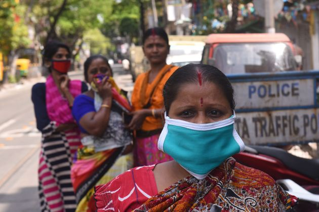 Women wearing masks on the streets of Kolkata during the nationwide