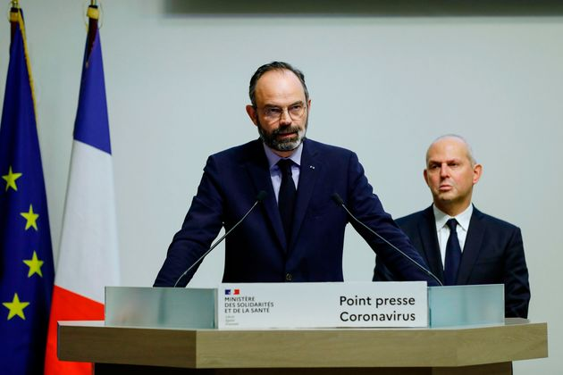 French Prime Minister Edouard Philippe speaks, flanked by French Director General of Health Jerome Salomon,...