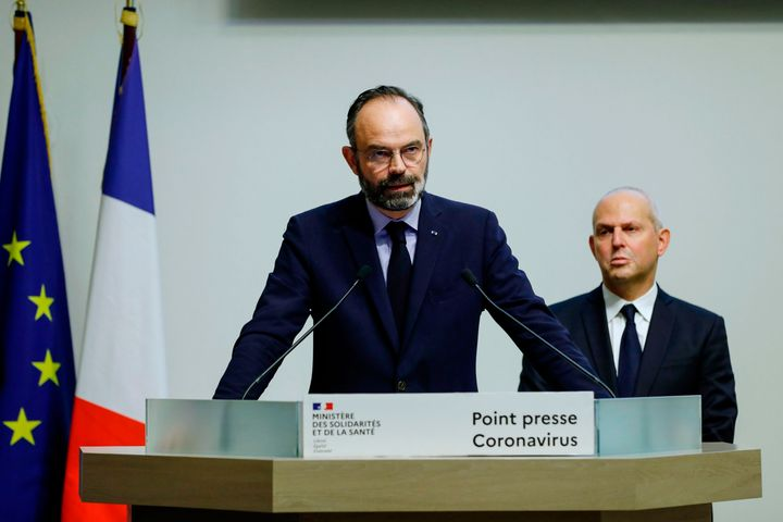 French Prime Minister Edouard Philippe speaks, flanked by French Director General of Health Jerome Salomon, as he announces n