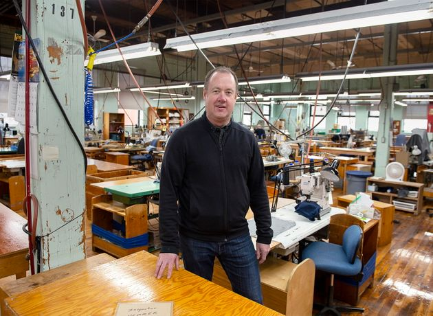 Jon Stanfield, president and CEO of Stanfield's, stands inside a production area at his company's facility...