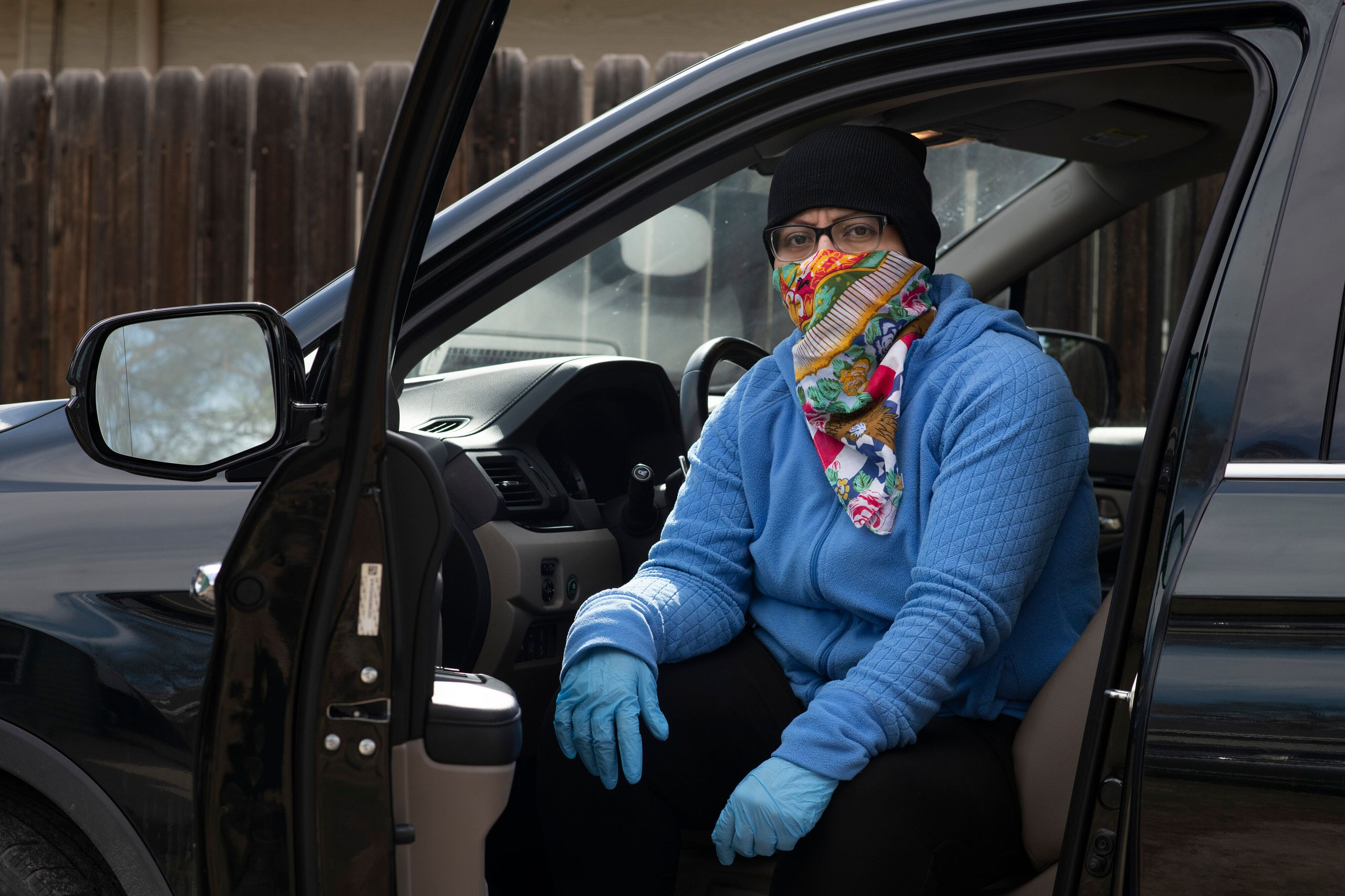 Dominguez poses in her deep cleaning outfit on March 30, 2020, at her house in Denver.