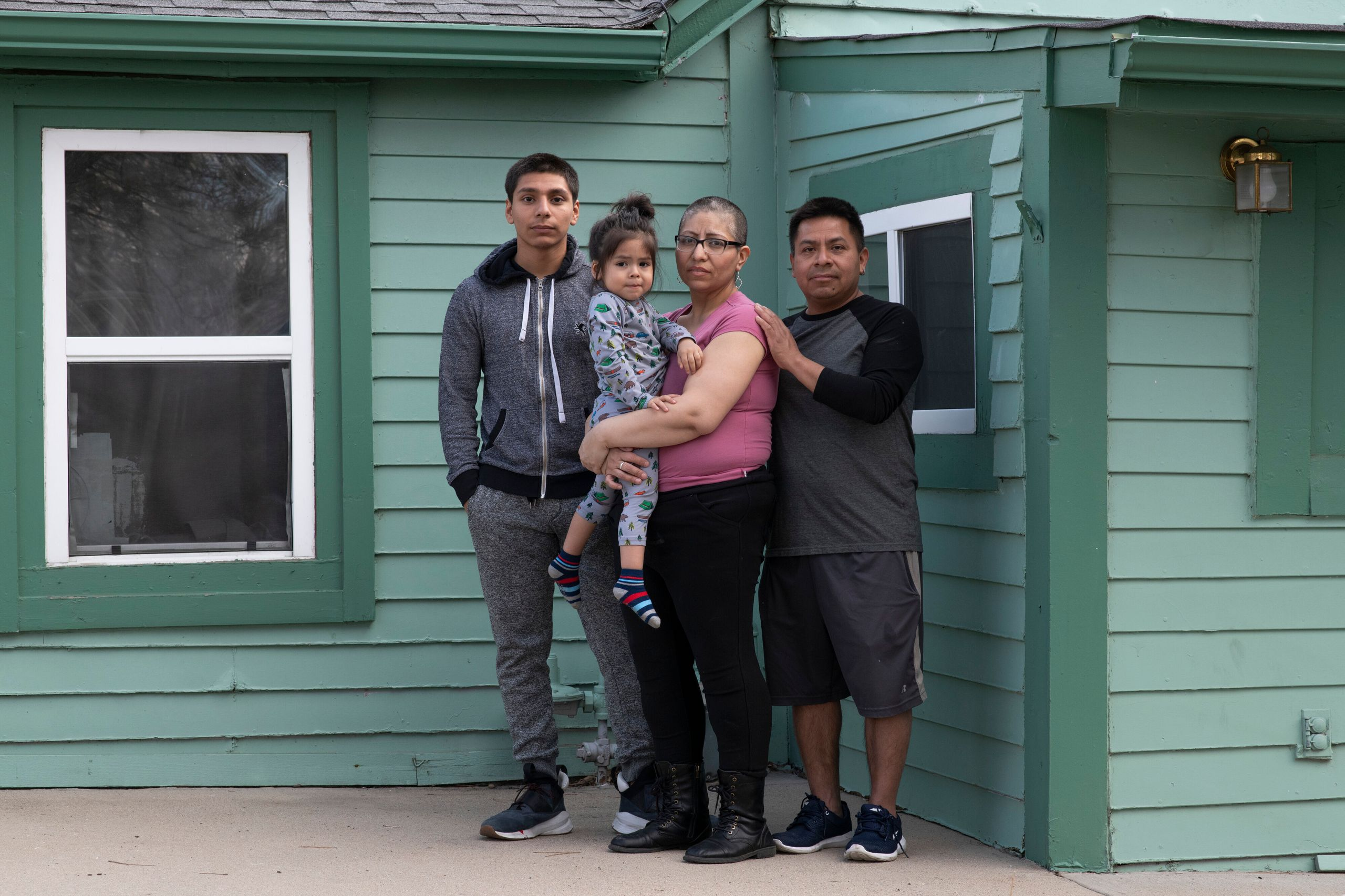 From left: Jorge Garcia, 15, stands with his mother, Ezzie Dominguez, who is holding her son Cristian Dominguez, 2, next to h
