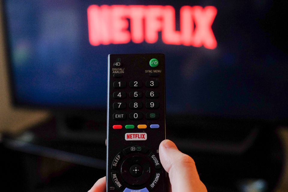 A person loads Netflix on their TV as people in the UK are being urged to socially distance in response...