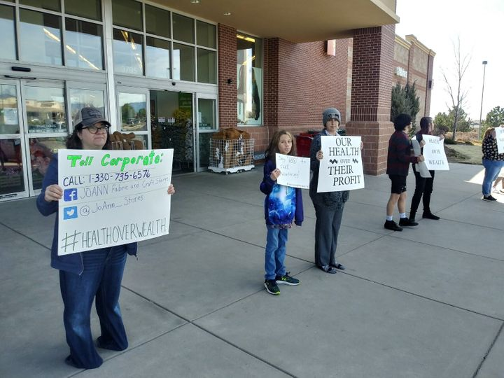 Workers and supporters outside a JoAnn's Fabrics and Crafts store in Colorado Springs last week. Jessica DeFronzo is third fr